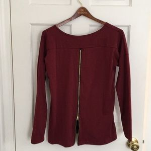 Long sleeve shirt with gold back zip. Brand new!